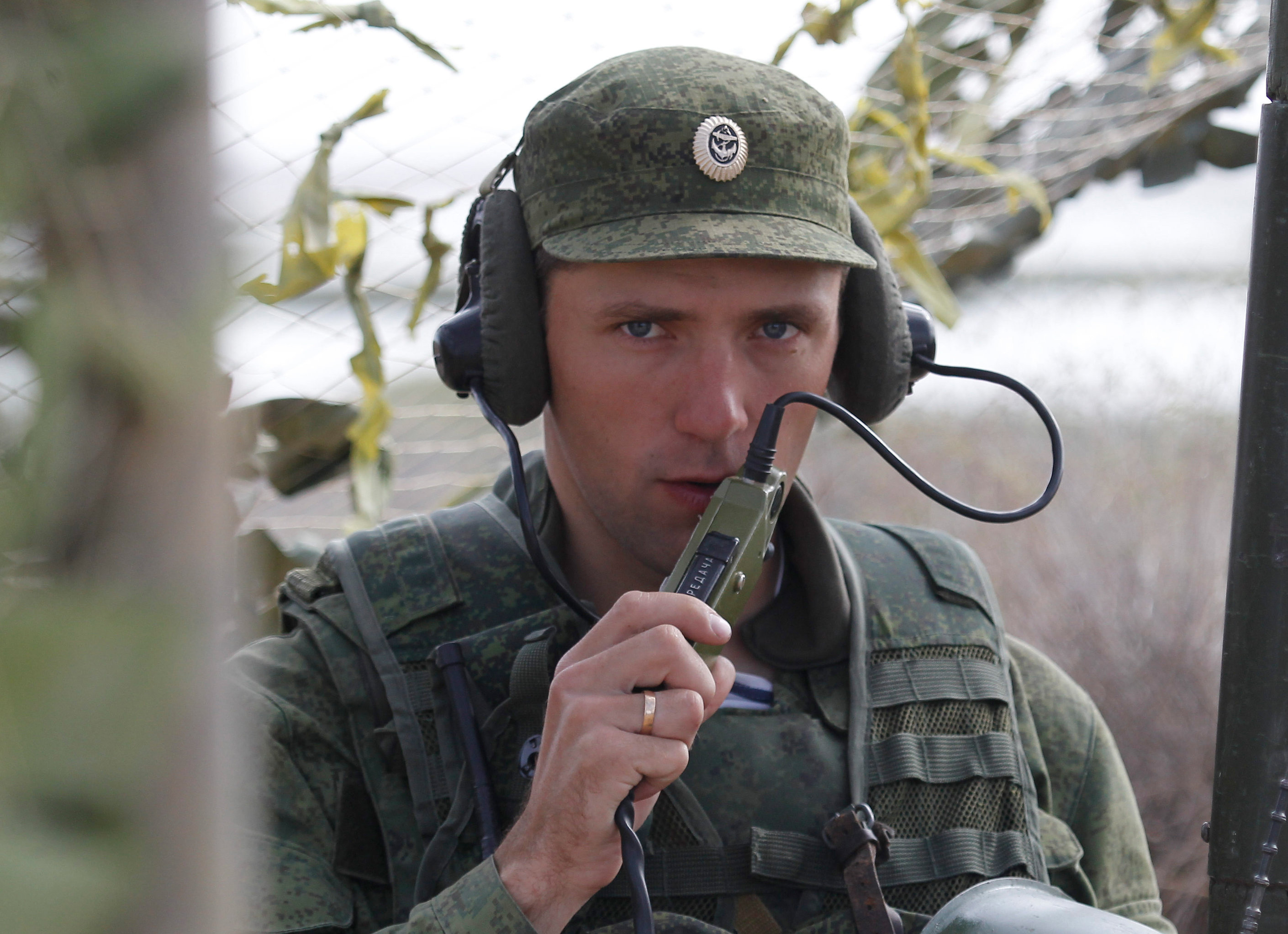 Russian serviceman establishing communication at the command house during the large-scale Center-2011 strategic exercises on the Oimasha range, Kazakhstan