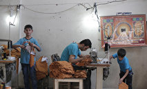 Syrian refugees, including children, work at a clothes workshop in Gaziantep, southeastern Turkey (File)
