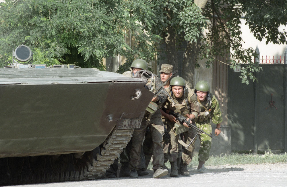 Spetsnaz soldiers prepare to storm a hospital in Budyonnovsk in the Stavropol Krai. The Budyonnovsk hospital hostage crisis took place on June 14-19, 1995, when a group of Chechen separatists attacked the southern Russian city of Budyonnovsk, killing 129 people and injuring 415.