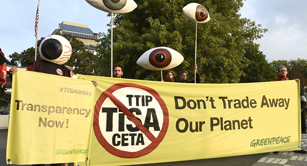 Greenpeace activists holding giants eyes demonstrate in front of Mission of the United Sates as the Trade In Services Agreement (TiSA) negotiations are taking place in Geneva, on September 20, 2016