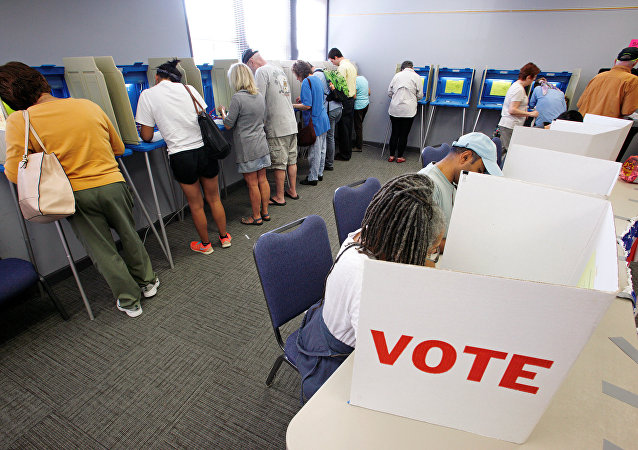 People cast their ballots for the 2016 general elections at a crowded polling station as early voting begins in North Carolina, in Carrboro, North Carolina, U.S., October 20, 2016