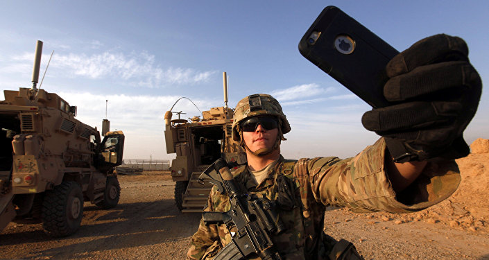An American soldier takes a selfie at the U.S. army base in Qayyara, south of Mosul October 25, 2016
