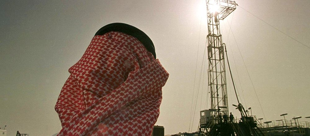 Khaled al Otaiby, an official of the Saudi oil company Aramco watches progress at a rig at the al-Howta oil field. fiel photo
