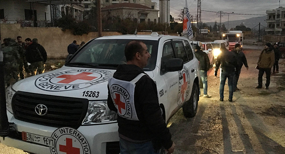 This picture provided by The International Committee of the Red Cross (ICRC), working alongside the Syrian Arab Red Crescent (SARC) and the United Nations (UN), shows a convoy containing food, medical items, blankets and other materials being delivered to the town of Madaya in Syria, Monday, Jan. 11, 2016