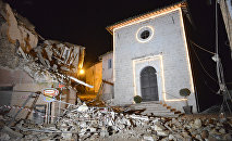 The Church of San Sebastiano stands amidst damaged houses in Castelsantangelo sul Nera, Italy, Wednesday, Oct 26, 2016 following an earthquake,.
