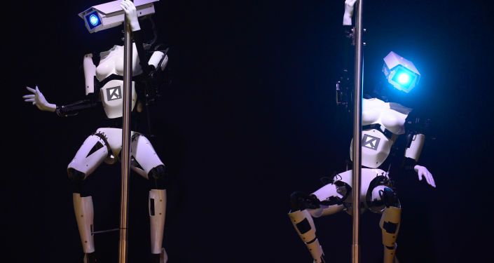 Robots from German company Tobit Software are brilliant pole dancers. The photo was made on the eve of the start of the 2014 CeBIT (Centrum für Büroautomation, Informationstechnologie und Telekommunikation) technology trade fair on March 9, 2014, in Hanover.