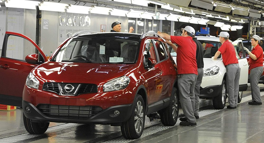 A worker is seen completing final checks on the production line at Nissan car plant in Sunderland, northern England, June 24, 2010.
