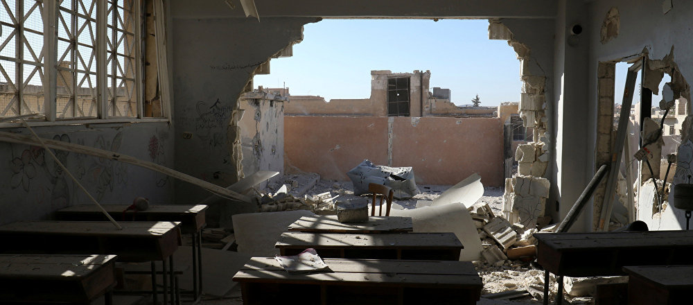 A damaged classroom is pictured after shelling in the rebel held town of Hass, south of Idlib province, Syria