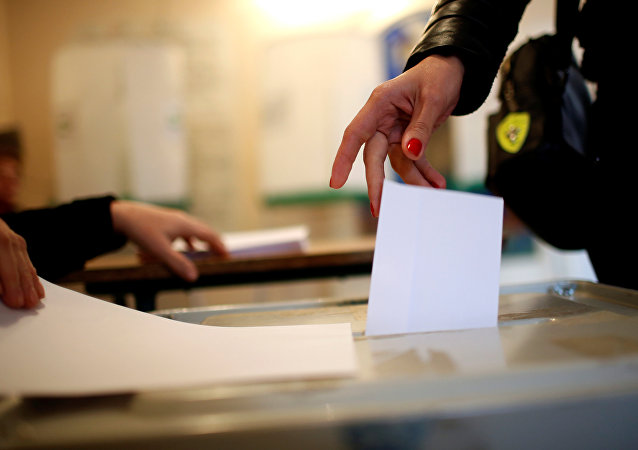 A woman casts her ballot during the second round of parliamentary election in Tbilisi, Georgia, October 30, 2016.