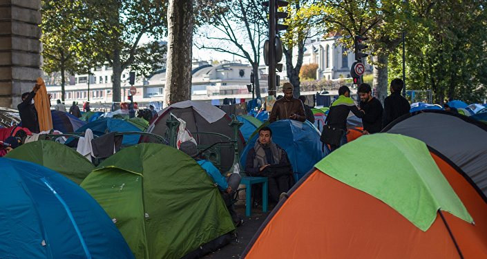 Migrants camp near the Stalingrad metro station in Paris