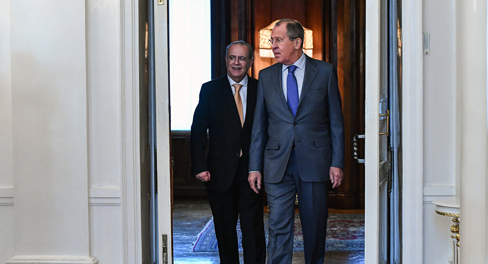 Russian Foreign Minister Sergei Lavrov, right, and his Cypriot counterpart Ioannis Kasoulides during a meeting at the Russian Foreign Ministry's Reception House