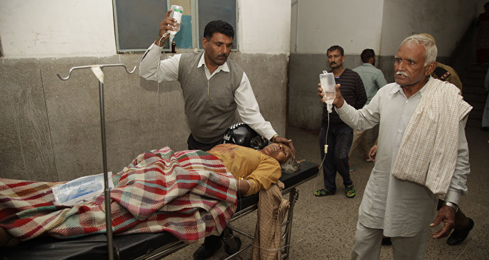 An Indian villager, allegedly injured from exploding shells fired by Pakistan, receives treatment at a hospital in Jammu, India, Nov. 1, 2016