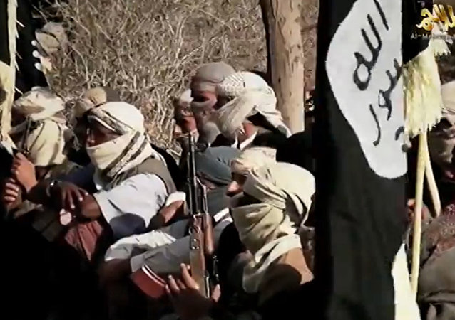 An image grab taken on April 16, 2014 from a video released on March 29, 2014 by Al-Malahem Media, the media arm of Al-Qaeda in the Arabian Peninsula (AQAP), allegedly shows AQAP jihadists listening to their chief Nasser al-Wuhayshi at an undisclosed location in Yemen