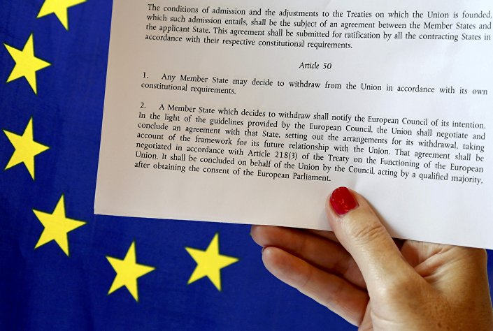 Article 50 of the EU's Lisbon Treaty that deals with the mechanism for departure is pictured near an EU flag following Britain's referendum results to leave the European Union, in this photo illustration taken in Brussels, Belgium, June 24, 2016.