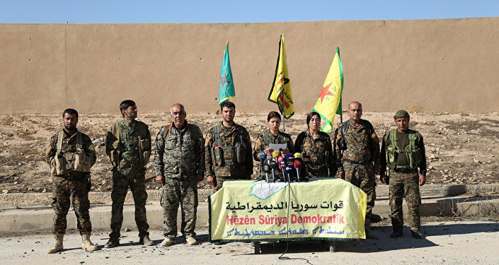 Syrian Democratic Forces (SDF) commanders attend a news conference in Ain Issa, Raqqa Governorate, Syria November 6, 2016.