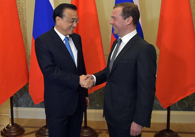 Russian Prime Minister Dmitry Medvedev and Chinese State Council Premier Li Keqiang during the 21st regular meeting between Russian and Chinese government heads in St. Petersburg