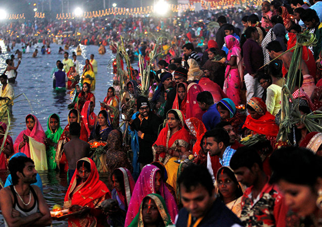 Hindu devotees gather to worship the Sun God on the banks of the Sun Lake during the religious festival of Chhat Puja in Chandigarh, India, November 7, 2016
