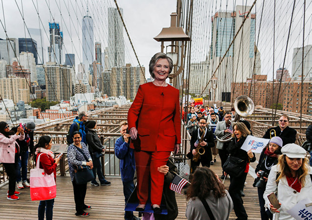 Supporters of U.S. Democratic presidential nominee Hillary Clinton take part in a march through the Brooklyn bridge in New York, U.S. October 22, 2016
