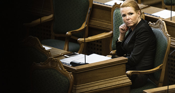 Denmark's Minister of Immigration and Integration Inger Stojberg listen to the debate in the Danish Parliament in Copenhagen (File)