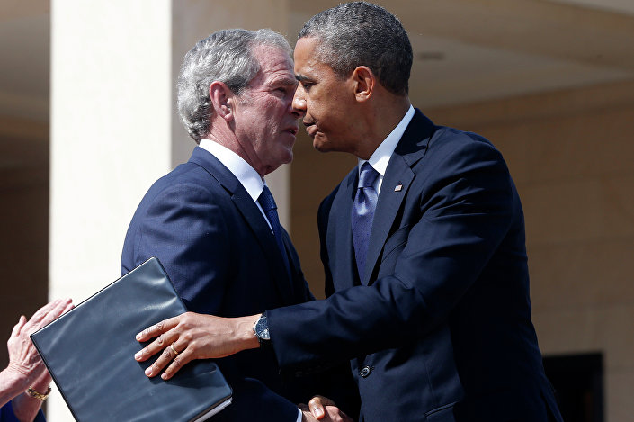 President Barack Obama embraces former President George W. Bush after he spoke at the dedication of the George W. Bush presidential library.