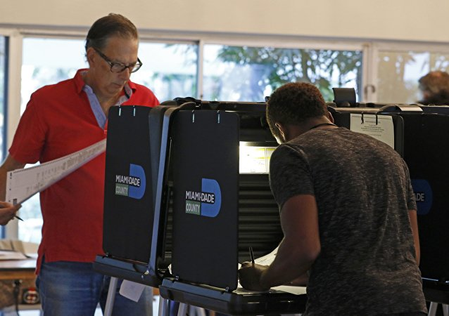 Voters in South Florida mark their ballots for the U.S. presidential election in Miami Beach, Florida, U.S. November 8, 2016