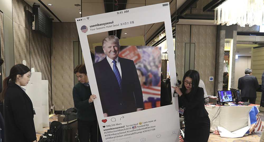 Officials carry a cardboard of Republican presidential candidate Donald Trump following an Election Watch event hosted by the U.S. Embassy in Seoul, South Korea, Wednesday, Nov. 9, 2016