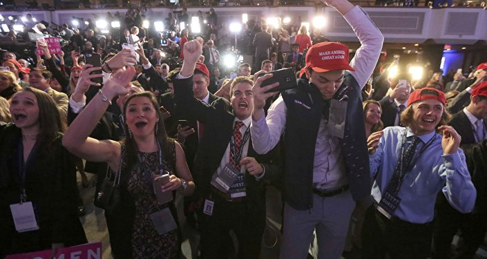 Supporters of U.S. Republican presidential nominee Donald Trump celebrate the results from Ohio and Florida at his election night rally in Manhattan, New York, U.S., November 8, 2016