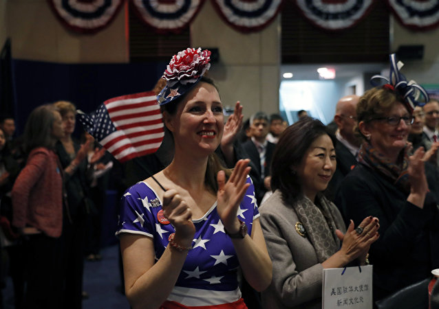 People watch a live telecast of the U.S. presidential election held at the U.S. embassy in Beijing, Wednesday, Nov. 9, 2016