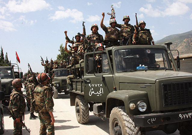 Syrian army soldiers standing on their military trucks
