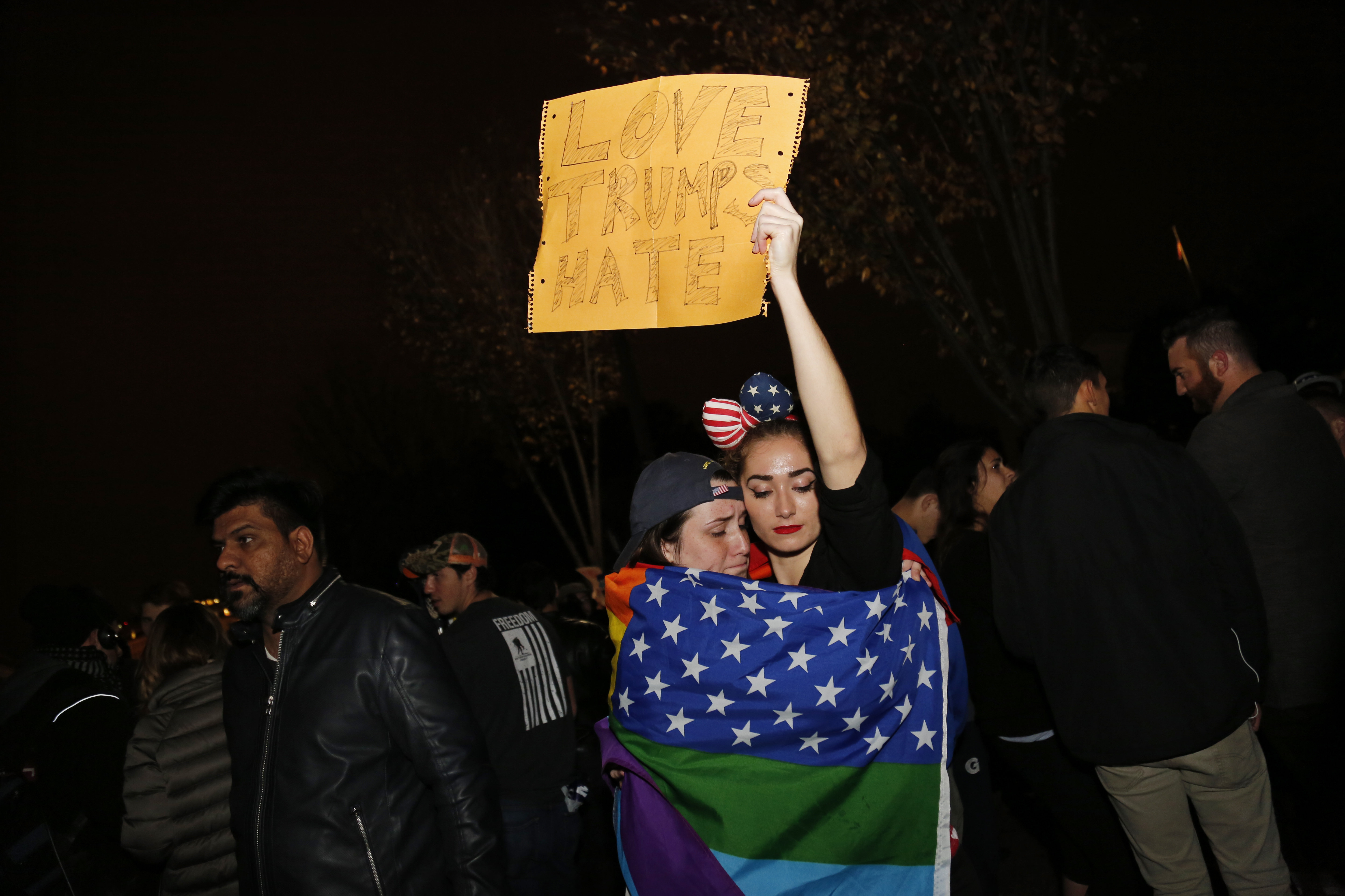 Supporters of Democratic presidential candidate Hillary Clinton react outside the White House early November 9, 2016 in Washington, DC