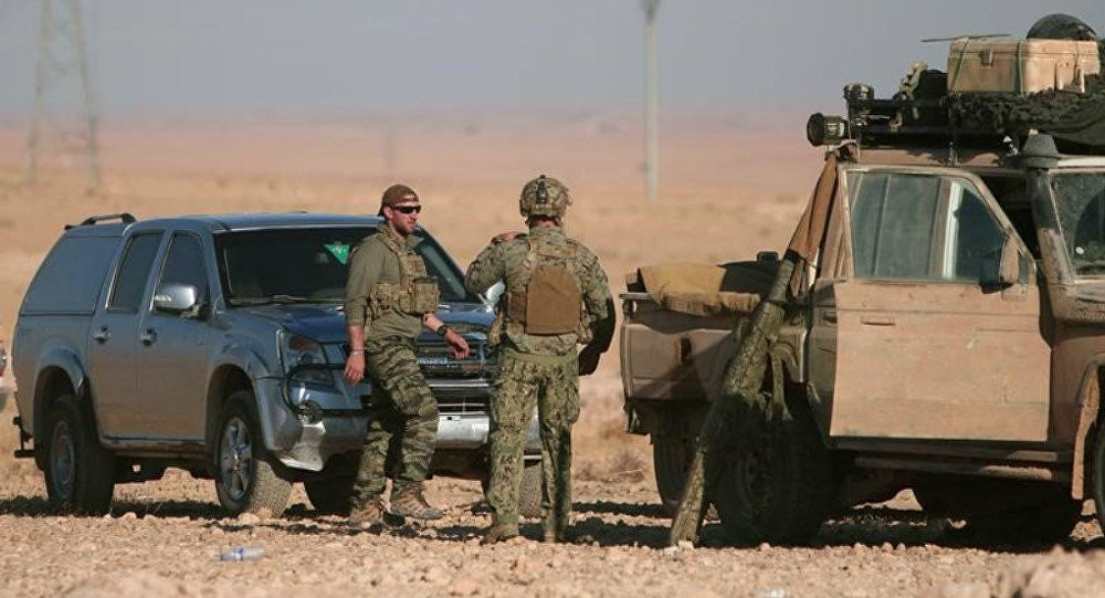 US soldiers stand near military vehicles, north of Raqqa city, Syria. File photo