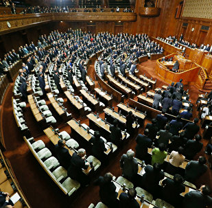Ruling coalition lawmakers stand to approve the passage of the Trans-Pacific Partnership (TPP) free trade deal in the lower house of the parliament in Tokyo on November 10, 2016