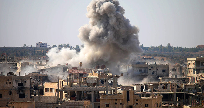 Smoke billows following an air strike by Syrian government forces in a rebel-held area of Daraa, in southern Syria, on October 26, 2016