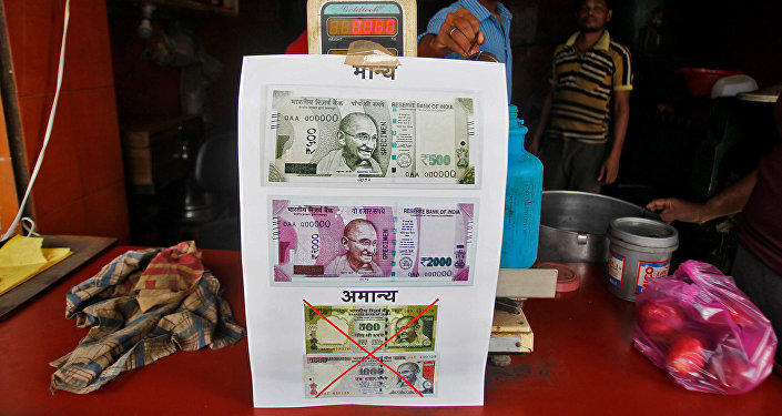A notice is pasted at a shop stating the refusal of the acceptance of the old 500 and 1000 Indian rupee banknotes and acceptance of the new 500 and 2000 Indian rupee banknotes, in Allahabad, India, November 10, 2016
