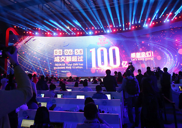 A screen shows real-time data of transactions at Alibaba Group's 11.11 Global shopping festival opening, in Shenzhen, Guangdong province, China, November 11, 2016