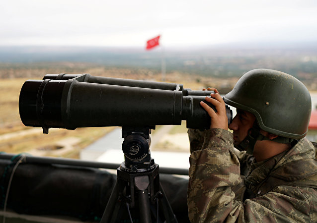 A Turkish soldier watches the border line between Turkey and Syria near the southeastern village of Besarslan, in Hatay province, Turkey, November 1, 2016