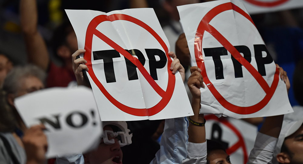 Delegates show their opposition to the Trans-Pacific Parternership Agreement (TPP) during Day 1 of the Democratic National Convention at the Wells Fargo Center in Philadelphia, Pennsylvania, July 25, 2016.