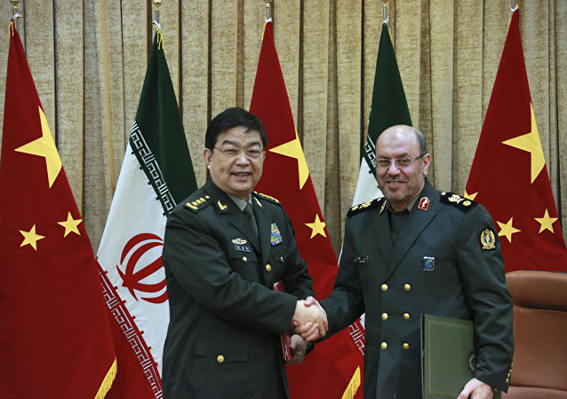 In this picture released by the Iranian Defense Ministry, Iranian Defense Minister Gen. Hossein Dehghan, right, and his Chinese counterpart Chang Wanquan shake hands after exchanging documents of an agreement in Tehran, Iran, Monday, Nov. 14, 2016.