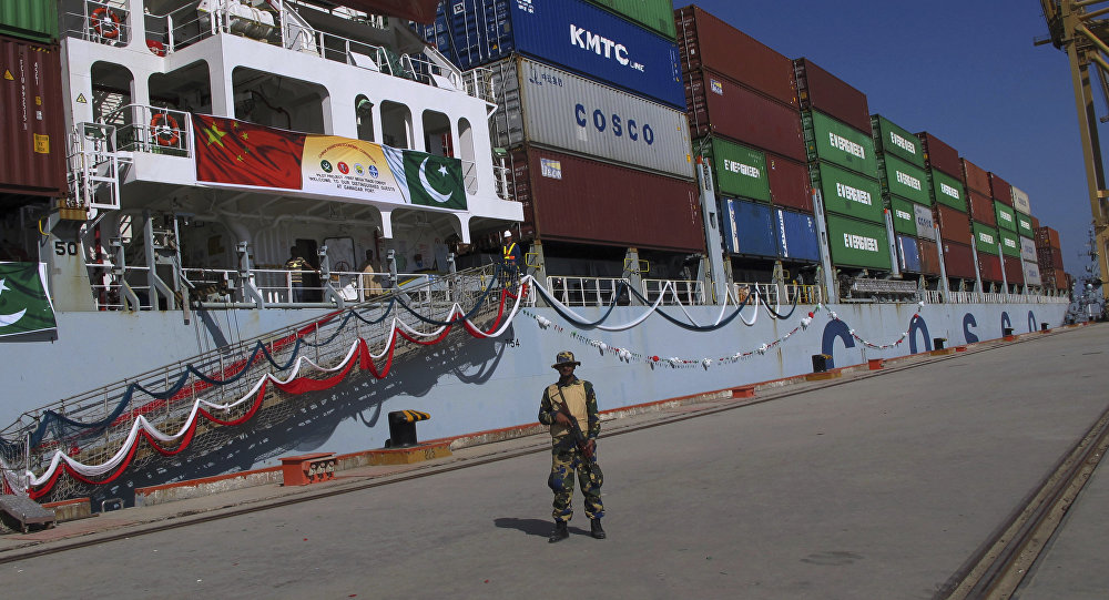A Pakistan Navy soldier stands guard while a loaded Chinese ship prepares to depart, at Gwadar port, about 700 kilometers (435 miles) west of Karachi. Pakistan, Sunday, Nov. 13, 2016.
