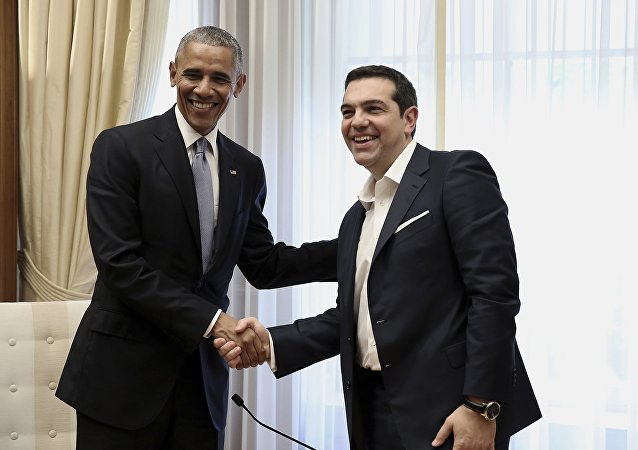 US President Barack Obama, left, shake hands with Greek Prime Minister Alexis Tsipras during their meeting at Maximos Mansion in Athens.