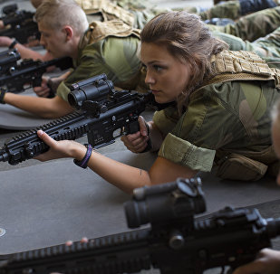 Female army recruits attend a base training at the armored battalion in Setermoen, northern Norway on August 11, 2016