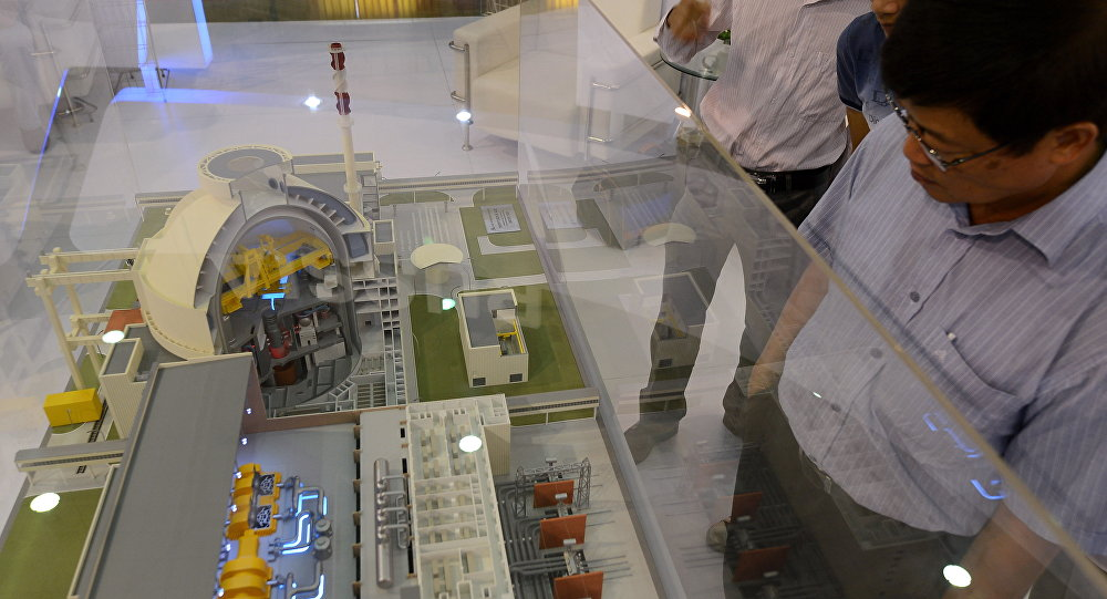 Visitors look at a model of a Russian VVER-1200 nuclear reactor of which Vietnam's first nuclear power plant will be equipped of on diplay at an international nuclear power exhibition being held in Hanoi on October 26, 2012