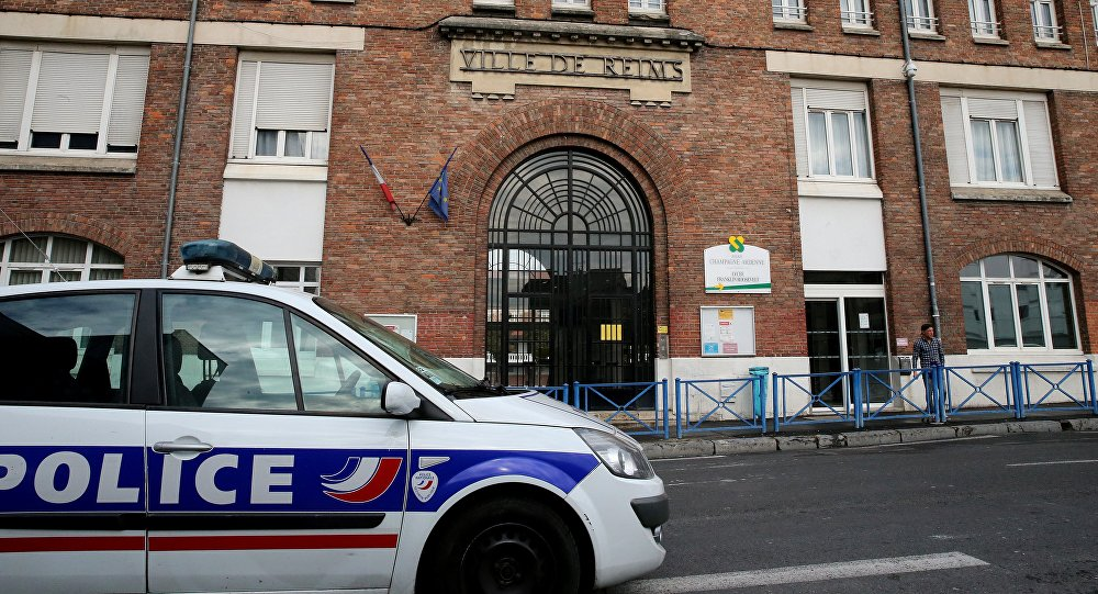 This photo taken on October 10, 2016 shows a police car parked in front of the Franklin D. Roosevelt high school in Reims, east of Paris, after a first grade student was badly injured outside the high school in an potential knife attack.