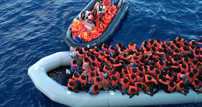 Migrants in a dinghy are rescued by the vessel Burbon Argos, run by Doctors Without Borders organization, in the Mediterranean sea, Friday, Nov. 4, 2016