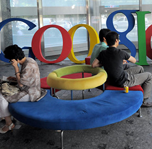 Visitors sit on a bench at a lobby of an office of Google Korea in Seoul on August 11, 2010