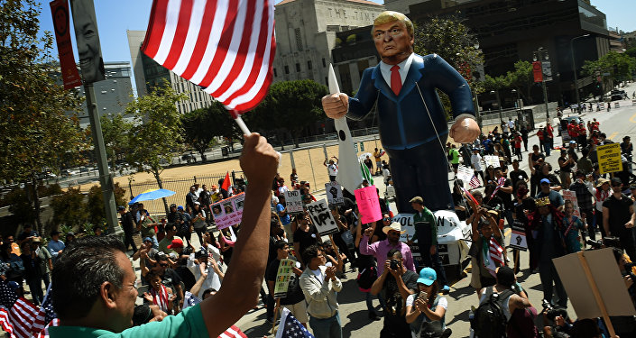 This file photo taken on May 01, 2016 shows Members of the 'Full Rights for Immigrants Coalition' displaying a giant effigy of US Republican Party presidential hopeful Donald Trump during a protest on May Day in Los Angeles, California on May 1, 2016