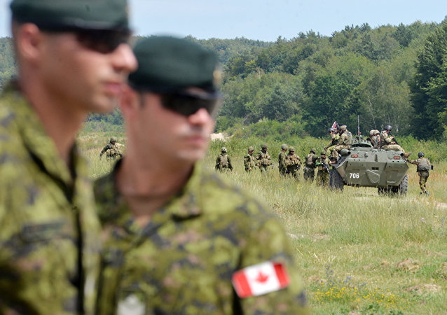 Canadian military instructors look on during Ukrainian military exercises at the International Peacekeeping and Security Center in Yavoriv, near Lviv(File)