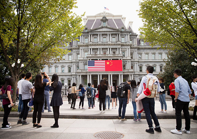 China's flag is displayed next to the American flag on the side of the Old Executive Office Building on the White House complex in Washington (File)
