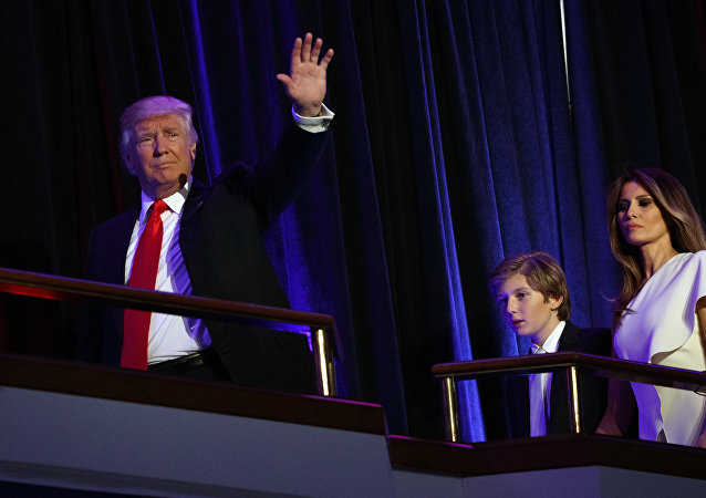 President-elect Donald Trump, left, walks with his son Barron, center, and wife Melania, to speak at an election night rally, Wednesday, Nov. 9, 2016, in New York