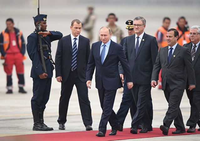 Russia's President Vladimir Putin walks upon arrival at Jorge Chavez International Airport in Lima to attend the Asia-Pacific Economic Cooperation (APEC) Summit on November 19, 2016